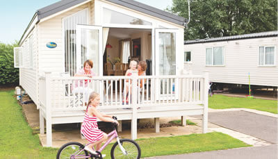 A family inside there caravan holiday home